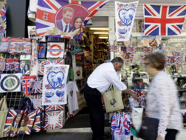 A woman passes a shop window decorated with royal wedding memorabilia in Windsor, England.
