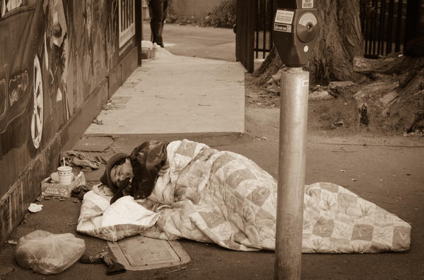 Homeless Person Sleeping in a Parking Lot