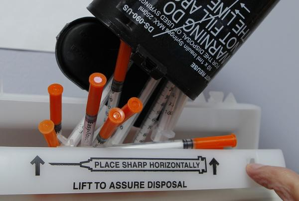 Hypodermic needles are disposed of at a clinic, Friday, Jan. 20, 2012. (Robert F. Bukaty/AP)