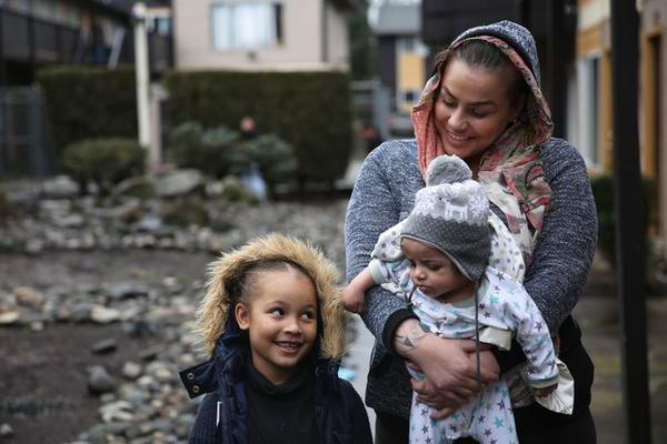 <p>Coya Crispin with her son, Titan, and her daughter, Saraia in the courtyard of Titan Manor. The family recently received a no-fault eviction notice.  </p>