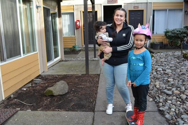 <p>Coya Crespin with son, Titan, and daughter, Saraia, outside their apartment at Titan Manor. On Thursday, Jan. 5, 2018, she and other tenants filed a lawsuit against the complex's new owners.</p>