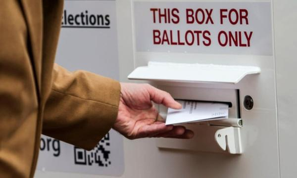 <p>A ballot is turned in at an official county ballot return box in Oregon.</p>