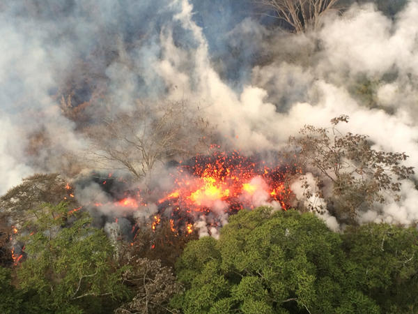 Another image provided by USGS shows lava spattering from an area between active Fissures 16 and 20 photographed at 8:20 a.m. HST, on the lower east rift of the Kilauea volcano, near Pahoa, Hawaii, on Wednesday.