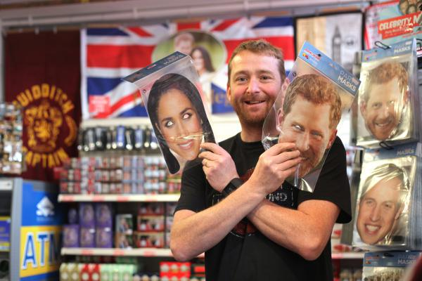 "Mike Drummond of the Red Bus souvenir shop. Most customers now, he says, are foreign tourists ""showing a lot of interest"" in Saturday's much-anticipated wedding in Windsor, England, of Prince Harry to Meghan Markle."