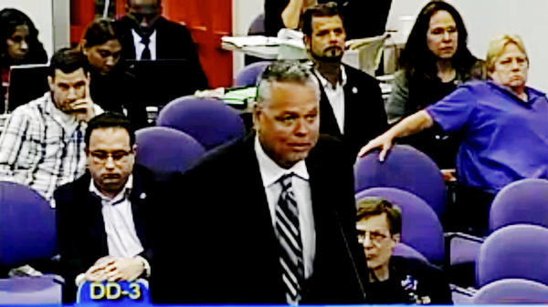 Scot Peterson addresses a Broward County school board meeting in 2015. The former school resource officer, criticized for remaining outside during the school shooting in Parkland, Fla., began receiving a monthly pension of more than $8,000 in April.