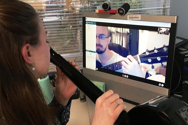 Diane Garrison Langston, a board-certified music therapist at the Gainesville, Fla. VA, is teaching Joshua Lawhorn guitar to help with his post traumatic stress and traumatic brain injury.
