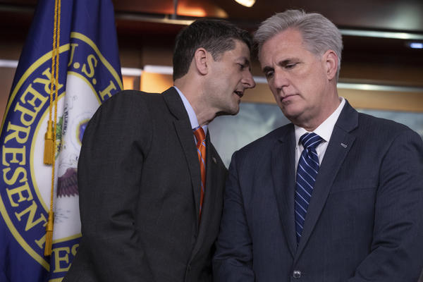 Speaker of the House Paul Ryan, R-Wis., confers with House Majority Leader Kevin McCarthy, R-Calif., during a news conference on Capitol Hill on Wednesday.