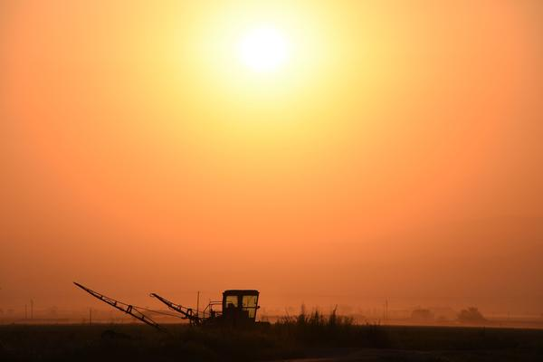 Farm equipment is parked in a field near Bakersfield, Calif., in a 2016 file photo. Congress is attempting to craft a new quadrennial farm bill that covers both agriculture programs and the Supplemental Nutrition Program, also known as food stamps.