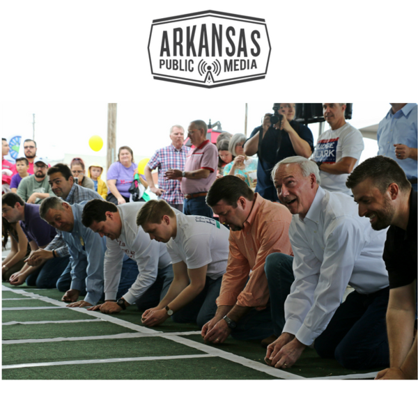 Gov. Asa Hutchinson (second from right) readies his toad for a harem-scarem hop to the finish line.
