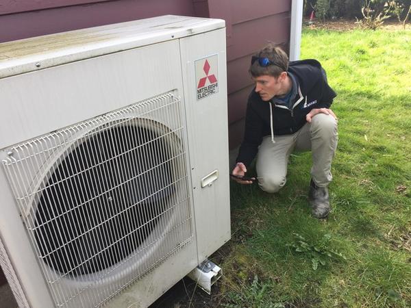 <p>Peter Kernan of Enhabit checks the efficiency of a heat pump system.</p>