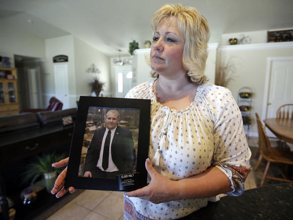 Laurie Holt holds a photograph of her son, Joshua Holt, at her home, in Riverton, Utah. Holt, who has been held in a Venezuelan jail for two years, uploaded a video plea for his released to Facebook this week.