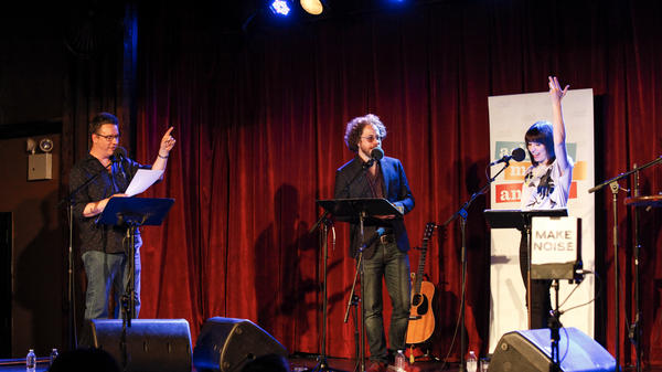 Greg Pliska challenges Jonathan Coulton and Ophira Eisenberg to a game on Ask Me Another at the Bell House in Brooklyn, New York.
