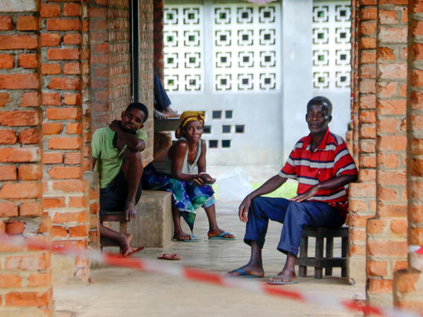 On May 13, people suspected of having the Ebola virus wait at a treatment center in the village of Bikoro, where the outbreak began in the Democratic Republic of the Congo.