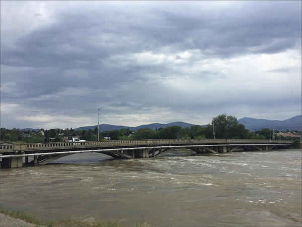 The flooded Okanogan River flowing through downtown Omak, Washington.