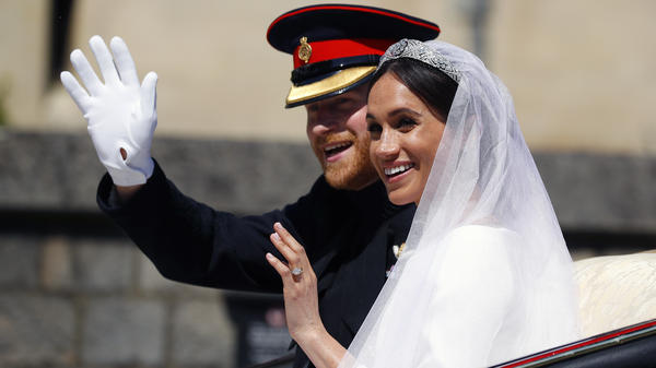 Britain's Prince Harry and his wife Meghan Markle ride a horse-drawn carriage, after their wedding ceremony at St. George's Chapel.
