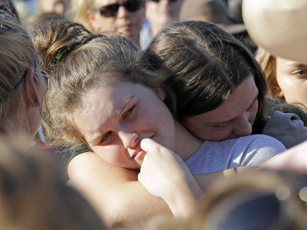 Santa Fe High School sophomore Averi Gary (center) is comforted during a vigil after the deadly mass shooting in Texas on Friday.