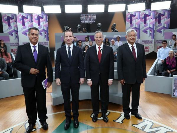 """In this photo released by the National Electoral Institute (INE), presidential candidates ( from left) independent Jaime Rodriguez, known as """"El Bronco,"""" Ricardo Anaya of the Forward for Mexico Coalition, Jose Antonio Meade, of the Institutional Revolutionary Party, and Andres Manuel Lopez Obrador, with the MORENA party, attend the second of three debates in Tijuana, Mexico, on Sunday."""