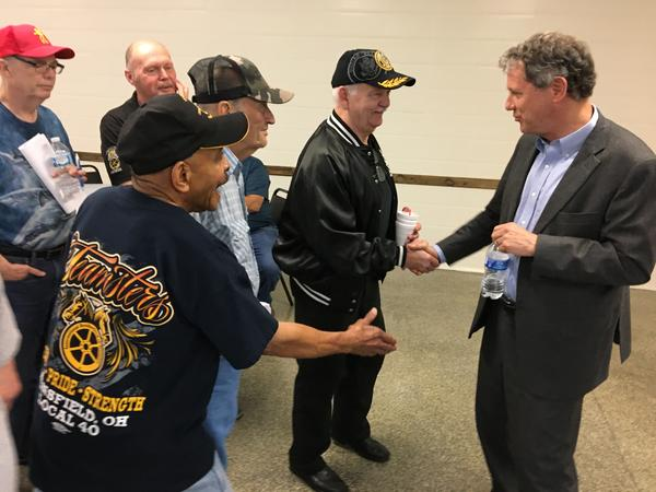 Sen. Sherrod Brown (right) shakes hands with retired unionized workers at Teamsters Local 413 in Columbus after his speech about the Butch Lewis Act.