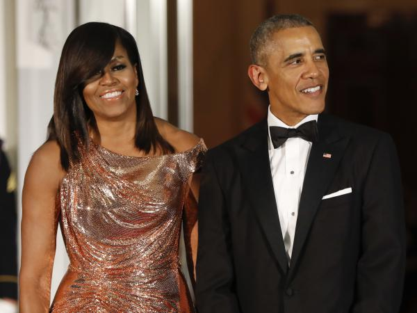 President Barack Obama and first lady Michelle Obama wait to greet Italian Prime Minister Matteo Renzi and his wife, Agnese Landini, for a State Dinner at the White House in Washington in 2016. Netflix says it has reached a deal with the Obamas to produce material for the streaming service.
