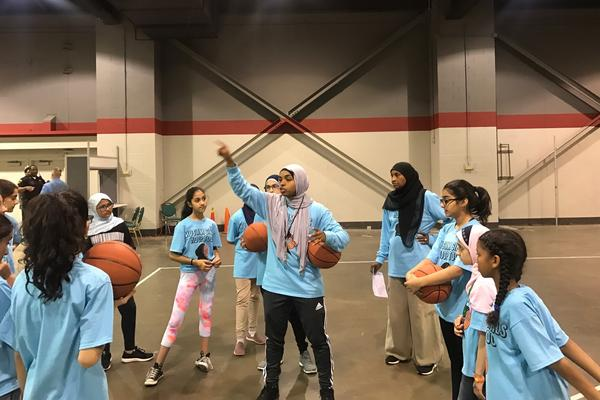 Bilqis Abdul-Qaadir coaches a clinic in Chicago.