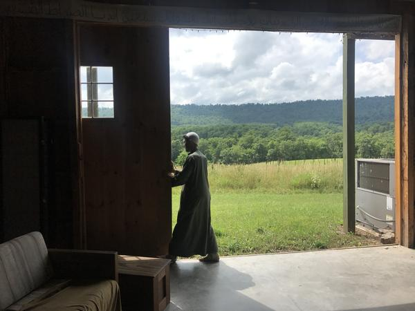 Imam Jamil Bastress opens the barn on their Sufi commune in rural Pennsylvania. They often pray here on Fridays.