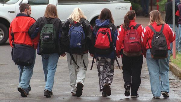 Students walk hand-in-hand to Thurston High School in Springfield, Ore. on May 26, 1998, the first day of classes after the May 21 shooting.