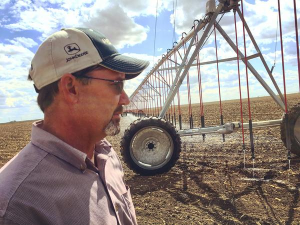 Farmer Clay Scott stands in front of one of his center-pivot irrigation systems.