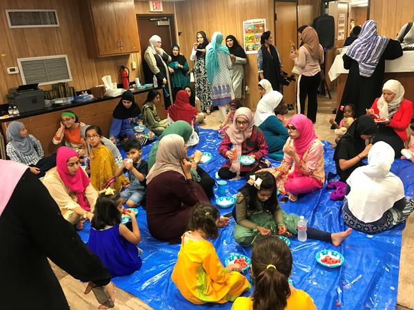 Families breaking their fast in the trailer turned mosque in Victoria, Texas. The mosque was burned down in an apparent hate crime in 2017.