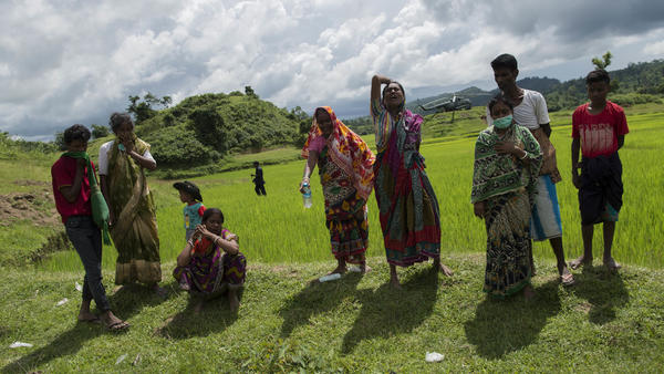 Hindu residents react in grief when shown the bodies of their dead family members in Maungdaw township last September, shortly after Myanmar's military announced that it had discovered a mass grave in Rakhine state.
