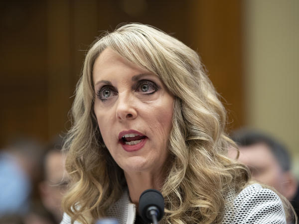 USA Gymnastics President and CEO Kerry Perry testifies on Capitol Hill on Wednesday about changes her organization has made to protect athletes from sexual abuse.
