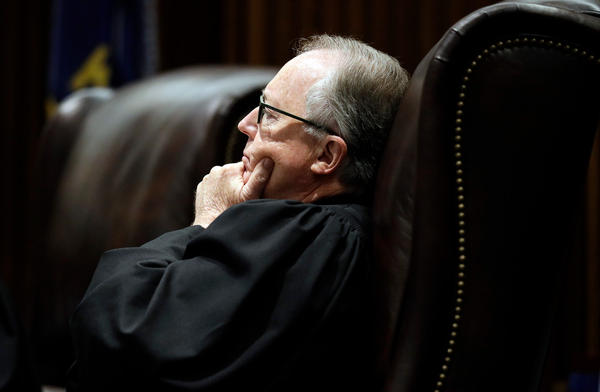 Senior Judge Michael Malone, sitting in for Justice Caleb Stegall,  listens to oral arguments in the Gannon v. Kansas school funding case.