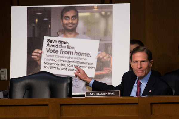 With a Twitter post — including a doctored photo that made it appear as if actor Aziz Ansari was encouraging voters to vote from home — displayed behind him, Sen. Richard Blumenthal, D-Conn. questions witnesses during an October 2017 Senate hearing on Russian disinformation during the 2016 campaign.