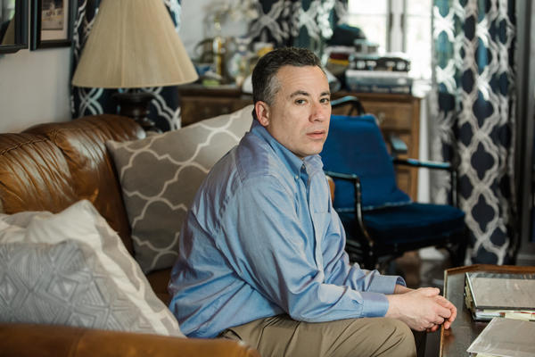 """""""As bad as NYU is, Aetna is equally culpable because Aetna's job was to be the checks and balances and to be my advocate,"""" said Michael Frank, seen at his home in Port Chester, N.Y."""