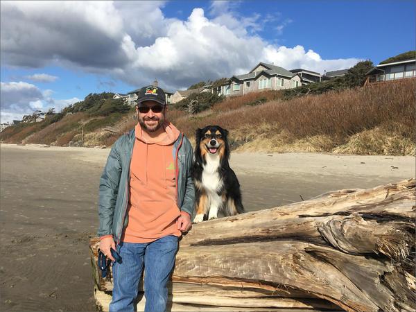 Retired veterinarian Bob Kroll with his 7-year-old Australian shepherd Betty in Cannon Beach, Oregon.