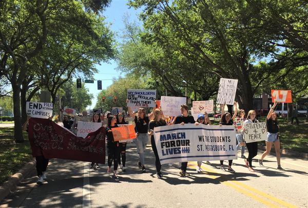 """Organizers said more than 3,000 people marched through the streets of downtown St. Petersburg with chants like """"Enough is enough."""""""