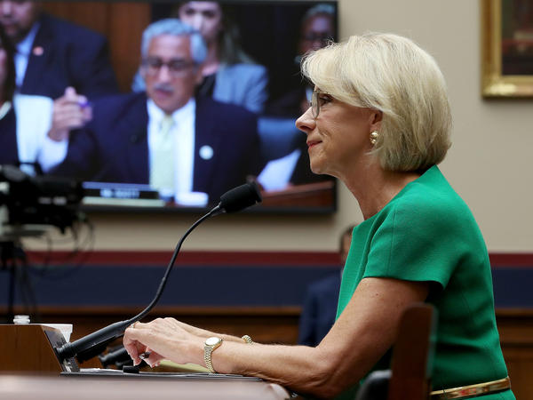 Education Secretary Betsy DeVos answers questions by Rep. Bobby Scott, D-Va., (on video screen) during a House Education and the Workforce Committee hearing on Capitol Hill.