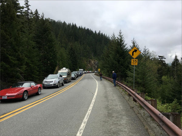 More than 100 vehicles joined WSDOT crews on Friday, May 11 to open the seasonal gate to SR 20's North Cascades Highway.