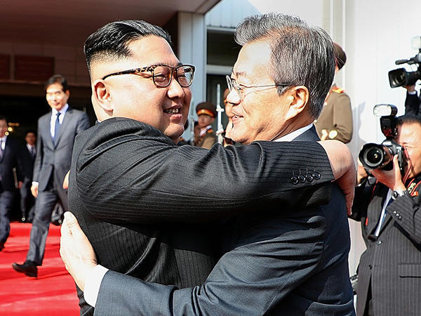 North Korean leader Kim Jong Un (left) and South Korean President Moon Jae-in embrace Saturday on the North Korean side of the shared inter-Korean area of Panmunjom.