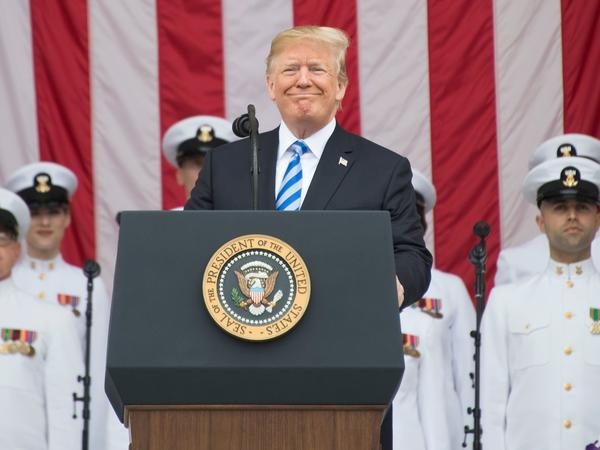 President Trump marks Memorial Day with a speech at Arlington National Cemetery on Monday.