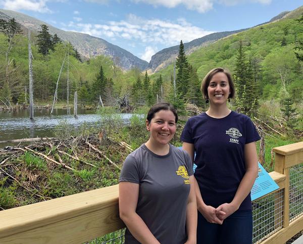 Green Mountain Club Field Supervisor Ilana Copel and Membership & Communications Coordinator Kristin McLane stand on the new Long Trail boardwalk, along a beaver pond.