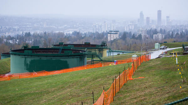 Oil tanks stand near the Trans Mountain pipeline expansion site in Burnaby, British Columbia, in April. The Canadian government bought the project in an effort to ensure it goes forward as the summer construction season nears.