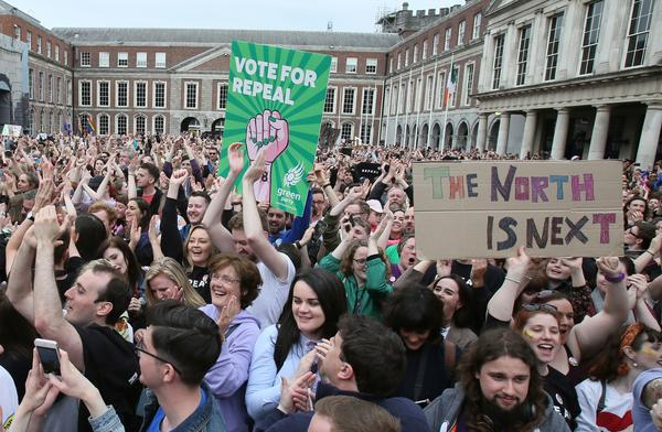 Demonstrators gather in Dublin on Saturday, awaiting the final results of Ireland's referendum on abortion. Ultimately, Irish voters backed repeal of the ban — but, as evidenced by their signs, those in favor of repeal were already thinking of what may happen next in Northern Ireland.
