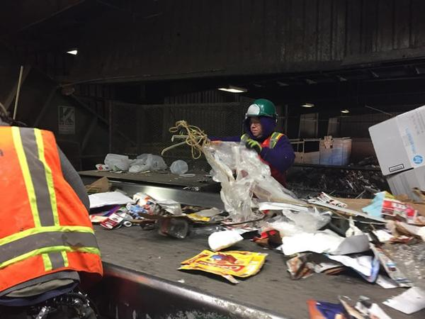 <p>Workers at the FarWest recycling facility in Hillsboro, Oregon, pull out contaminants like plastic and rope from the recycling that people put in their curbside recycling bins.</p>