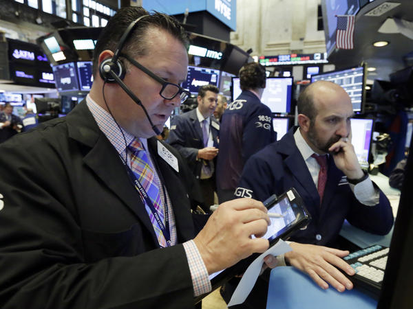 Trader Edward Curran (left) and specialist James Denaro on the floor of the New York Stock Exchange Tuesday. The political turmoil in Italy sent stocks down sharply.