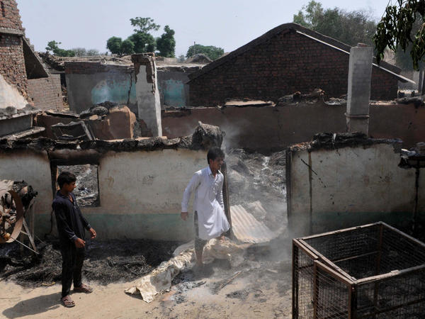 Villagers inspects the damage after their home were gutted by firing from the Pakistan side of the border at Jora farm village last week in Ranbir Singh Pura district of Jammu, India.