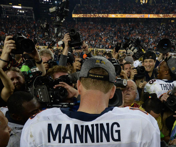 Peyton Manning wades through a swarm of media after the Broncos defeated the Panthers. It is his second Super Bowl victory.