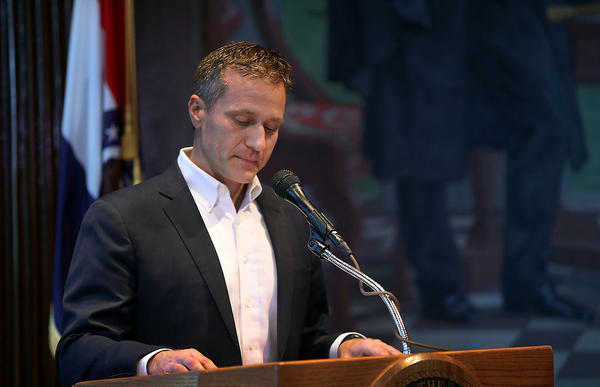 Missouri Gov. Eric Greitens reads from a statement announcing his resignation on Tuesday.