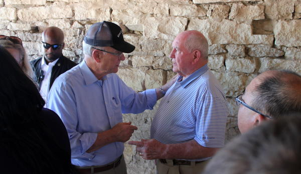 U.S. Sen. Pat Roberts and Agriculture Secretary Sonny Perdue speak at a farm meeting outside Manhattan on Wednesday.
