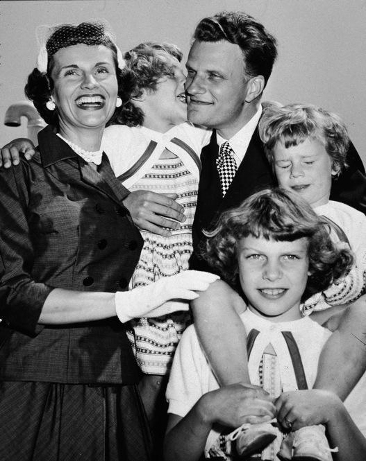 Graham met his wife, Ruth McCue Bell (1920-2007), while both were classmates at Wheaton College. They married two months after their graduation and went on to have five children. Clockwise from left: Ruth Graham, Anne, Billy Graham, Ruth (Bunny) and Virginia.