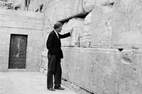 Graham stands by the Western Wall in Jerusalem on March 17, 1960. Graham was on an 18,000-mile preaching tour of Africa and the Middle East.